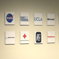 AtHoc uses fotoflōts to create a photo wall of customer logos. Businesses, government agencies and nonprofit organizations all use fotoflōts to tell their stories with photos.   fotoflōt displays images without picture frames, glass, mattes, or glare. Images float off the wall or desk and are held in place with magnets. fotoflōt can be used for photo display and to create photo collages, photo walls, diptychs and triptychs. fotoflōts can be created directly from images at Picasa, Kodak Gallery, SmugMug, Zenfolio, ACDSee and other online services.