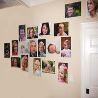 An organic family photo wall created by Ross Peebles. He integrated the wall switch and the door into the design of the family photo wall. fotoflōt displays images without picture frames, glass, mattes, or glare. Images float off the wall or desk and are held in place with magnets. fotoflōt can be used for photo display and to create photo collages, photo walls, diptychs and triptychs. fotoflōts can be created directly from images at Picasa, Kodak Gallery, SmugMug, Zenfolio, ACDSee and other online services.