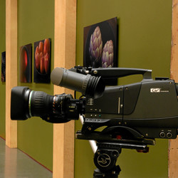 "The set of the TV series ""Check Please !"" at WTTW in Chicago. Shows a HDTV camera with fotoflōts in the background. fotoflōt displays images without picture frames, glass, mattes, glare, or reflection. Images float off the wall or desk and are held in place with magnets. fotoflōt can be used for photo display and to create photo collages, photo walls, diptychs and triptychs. fotoflōts can be created directly from images at Picasa, Kodak Gallery, SmugMug, Zenfolio, ACDSee and other online services."